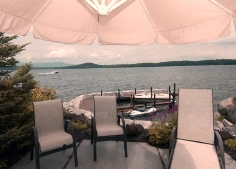 Outdoor Patio Area with Boat and Ocean View