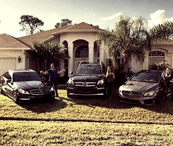 Mercedes familyOn mansion front lawn